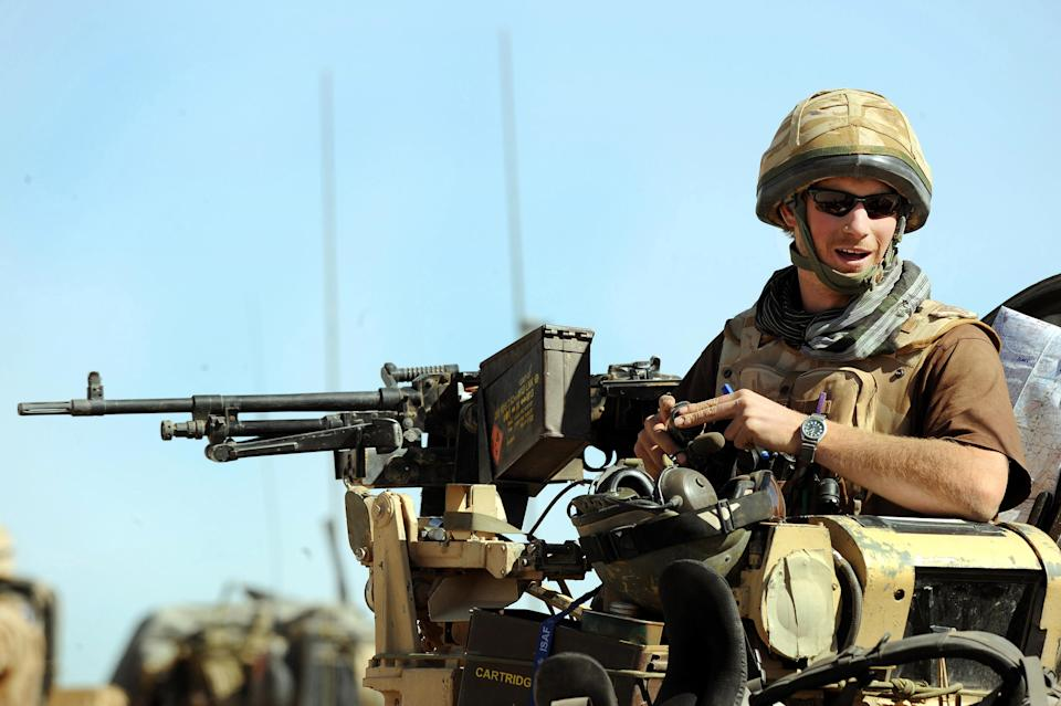Prince Harry sits atop a spartan armoured vehicle on January 2, 2008 in Helmand Province, Afghanistan