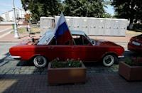 A Russian Volga car is seen decorated with a flag in the centre of Kaliningrad, Russia, June 28, 2018. REUTERS/Kacper Pempel