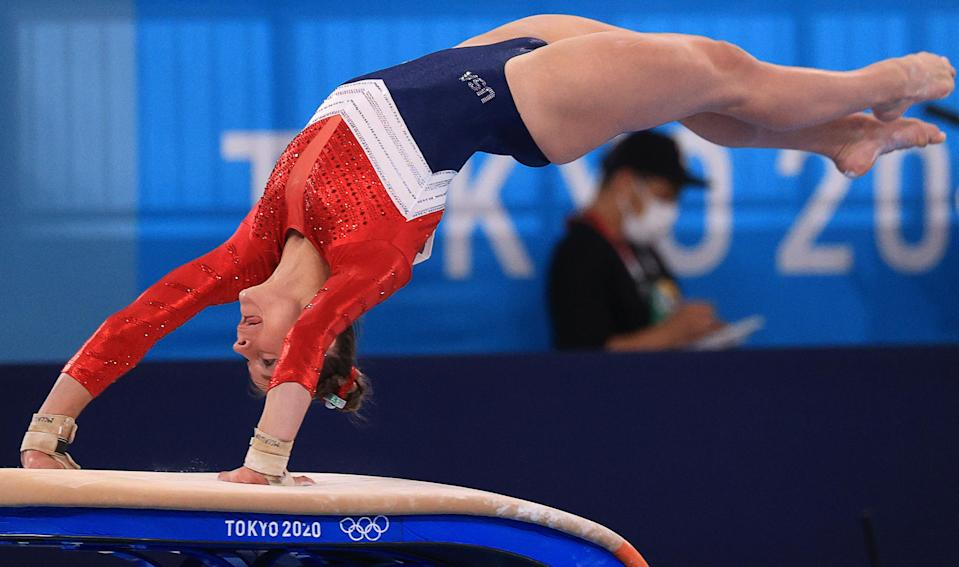 Grace McCallum flips on the vault with her hands on the vault during the all-around final