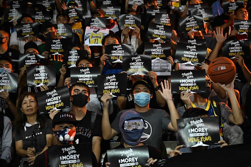 "Protesters shout slogans as they hold flyers at the Southorn Playground in Hong Kong on October 15, 2019, during a rally in support of NBA basketball Rockets general manager Daryl Morey and against comments made by Lakers superstar LeBron James. - US basketball superstar LeBron James on October 14, 2019, has sharply criticised a Houston Rockets executive for angering China with a tweet supporting protesters in Hong Kong, saying the executive was ""misinformed"" and should have kept his mouth shut. (Photo by Anthony WALLACE / AFP) (Photo by ANTHONY WALLACE/AFP via Getty Images)"