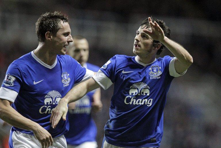 Everton's Leighton Baines (right) , who scored five goals in the Premiership last season, is a good buy for your team. (AFP file photo)