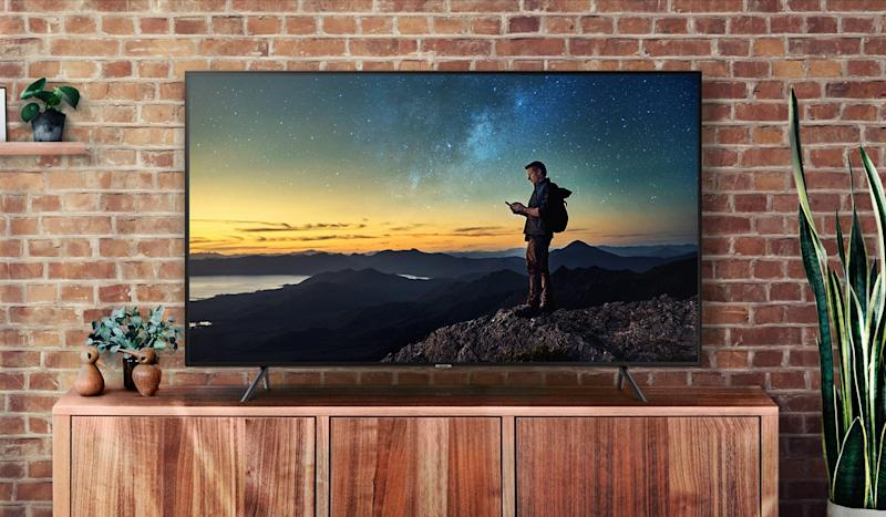 Save a whopping 54 percent off this massive 75-inch Samsung 4K TV. (Photo: Walmart)
