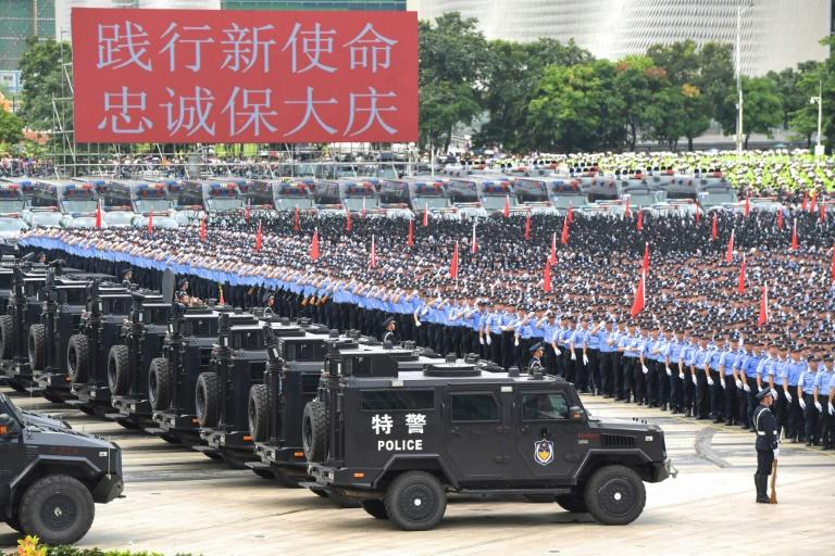 Chinese police officers take part in a drill in Shenzhen, across the border from Hong Kong