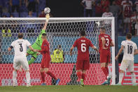 Turkey's goalkeeper Ugurcan Cakir makes a save against Italy's Giorgio Chiellini during the Euro 2020 soccer championship group A match between Italy and Turkey at the Olympic stadium in Rome, Friday, June 11, 2021. (Alberto Lingria/Pool Photo via AP)