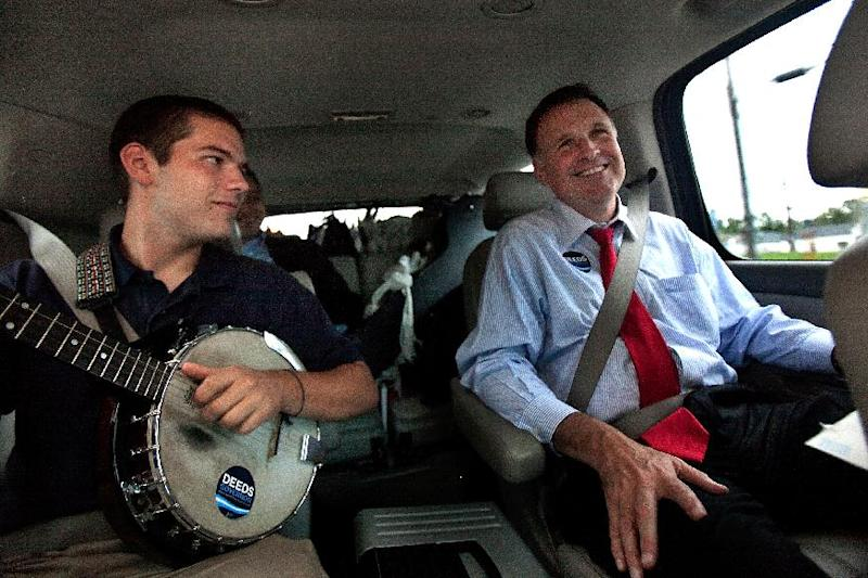 In a Sept. 25, 2009 photo, Democratic gubernatorial candidate Creigh Deeds spends time with his son Gus, left, on the road to Halifax, Va., between campaign events. Virginia State Police confirmed Tuesday, Nov. 19, 2013, that Creigh Deeds was stabbed multiple times and his son Gus, 24, was shot and killed at Deeds' Home in Bath County, Va., during a Tuesday morning assault. (AP Photo/The Virginian-Pilot, Hyunsoo Leo Kim)