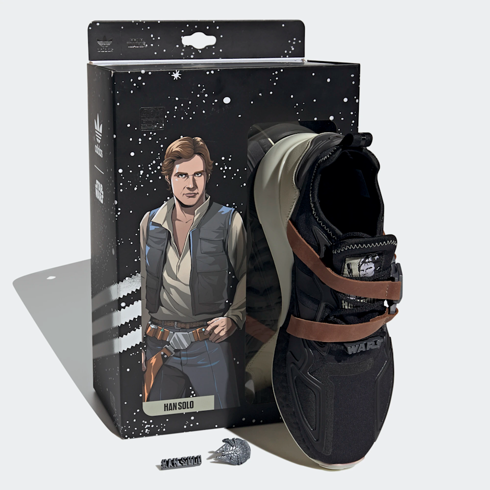 """Star Wars. Enough said. Luckily you'll find these Han Solo inspired sneakers just as cool as he does. <br><br><strong>Adidas</strong> Star Wars ZX 2K Boost Shoes, $, available at <a href=""""https://go.skimresources.com/?id=30283X879131&url=https%3A%2F%2Fwww.adidas.com%2Fus%2Fstar-wars-zx-2k-boost-shoes%2FFX9113.html"""" rel=""""nofollow noopener"""" target=""""_blank"""" data-ylk=""""slk:Adidas"""" class=""""link rapid-noclick-resp"""">Adidas</a>"""