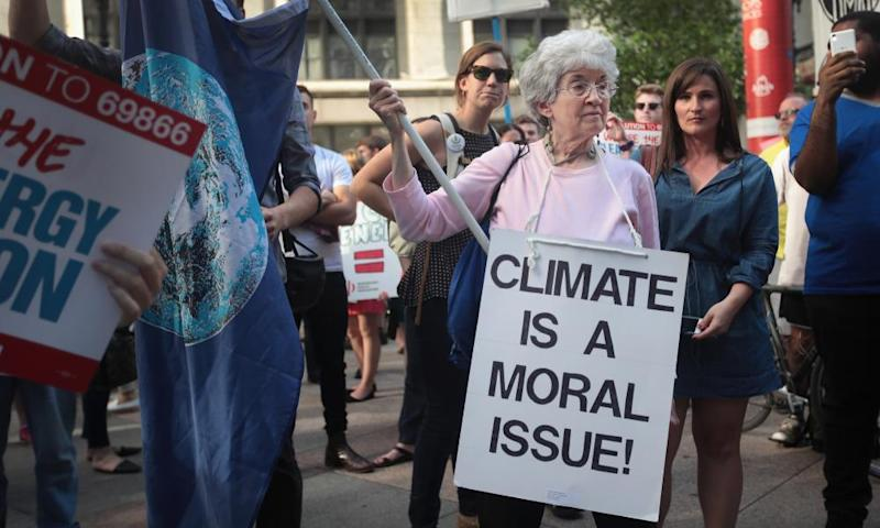 Environmental activists protest Donald Trump's decision to exit the Paris climate accords, which sets a goal of avoiding warming beyond 2C.
