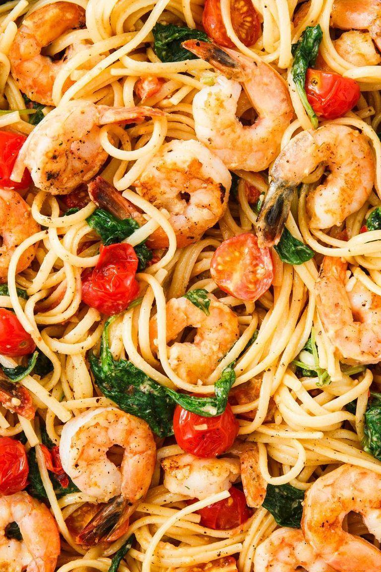 """<p>Linguine with tomatoes, greens, and prawns in a buttery sauce = bomb.</p><p>Get the <a href=""""https://www.delish.com/uk/cooking/recipes/a30219265/creamy-shrimp-linguine-tomatoes-kale-lemon-zest-recipe/"""" rel=""""nofollow noopener"""" target=""""_blank"""" data-ylk=""""slk:Creamy Prawn Linguine"""" class=""""link rapid-noclick-resp"""">Creamy Prawn Linguine</a> recipe.</p>"""