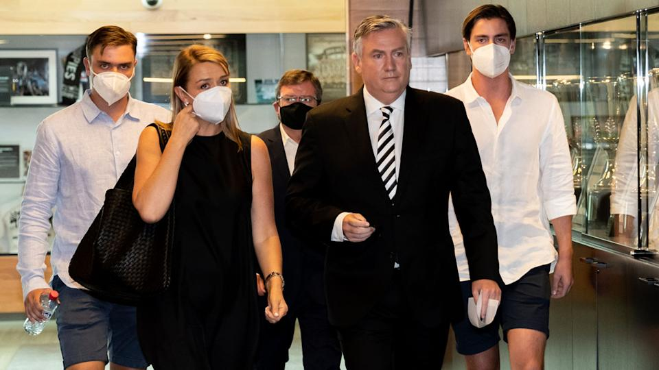Eddie McGuire and his family, pictured here on their way to speak to the media before his resignation.