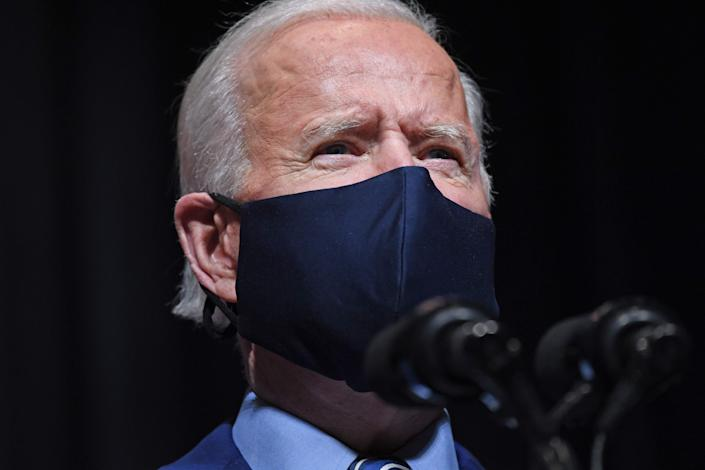 President Joe Biden speaks during a visit to the National Institutes of Health (NIH) in Bethesda, Maryland, Feb. 11, 2021.