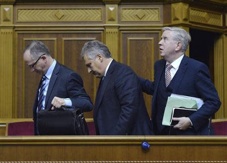 Former Polish President Aleksander Kwasniewski and former European Parliament President Pat Cox (R) leave a session of the Parliament in Kiev November 13, 2013. REUTERS/Stringer