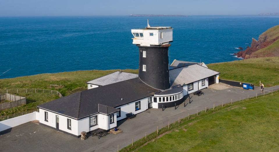 The restored lighthouse sits on the edge of the Pemrokeshire coast (SWNS)