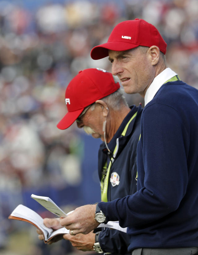 US team captain Jim Furyk watches the singles on the final day of the 42nd Ryder Cup at Le Golf National in Saint-Quentin-en-Yvelines, outside Paris, France, Sunday, Sept. 30, 2018. (AP Photo/Laurent Cipriani)