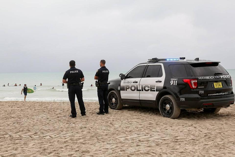 Miami Beach police officers at South Pointe Beach on Sunday, August 2, 2020.