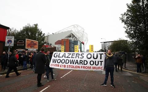 Protestors outside Old Trafford - Credit: Getty Images