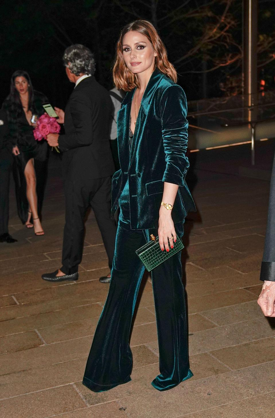 <p>Style maven Palermo made us all want a green velvet suit immediately when she stepped out in one for the ballet. Keeping her evening look sulty, she paire it with ust a lace bodice worn underneath.<em>[Photo: Getty]</em> </p>