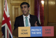 In this image made available by British government because no media allowed into 10 Downing Street because of the coronavirus pandemic, showing Chancellor of the Exchequer Rishi Sunak holding a digital press conference about the COVID-19 coronavirus, in 10 Downing Street, London, Thursday March 26, 2020. Sunak on Thursday announced measures to give financial help to self-employed people. (Pippa Fowles/10 Downing Street via AP)