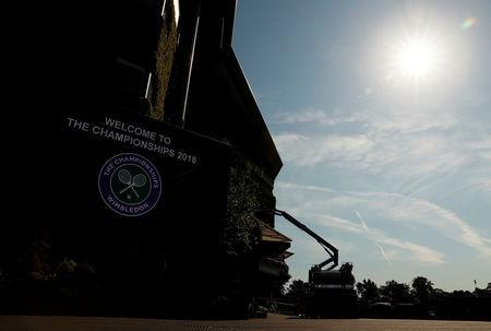 FILE PHOTO: Tennis - Wimbledon Preview - All England Lawn Tennis and Croquet Club, London, Britain - July 2, 2018 Ground staff prepare. REUTERS/Andrew Couldridge/File Photo
