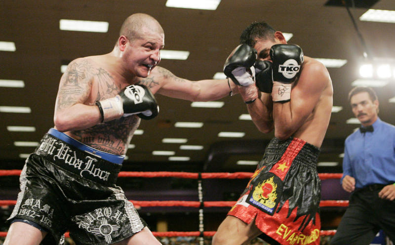 FILE - In this Feb. 23, 2007, file photo, five-time world champion Johnny Tapia, left, connects with Evaristo Primero in the ninth round of a 10-round junior welterweight bout at Isleta Pueblo, N.M. Police Sunday May 27, 2012,say five-time world boxing champion Tapia has been found dead by a family member at his home in Albuquerque, N.M. (AP Photo/Jake Schoellkopf, File)