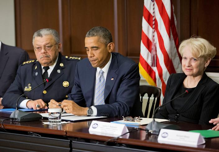 Obama with Laurie Robinson, right, Clarence J. Robinson Professor of Criminology, Law, & Society at George Mason University, and Charles Ramsey, left, then commissioner of the Philadelphia Police Department, during a meeting  about his Task Force on 21st Century Policing.