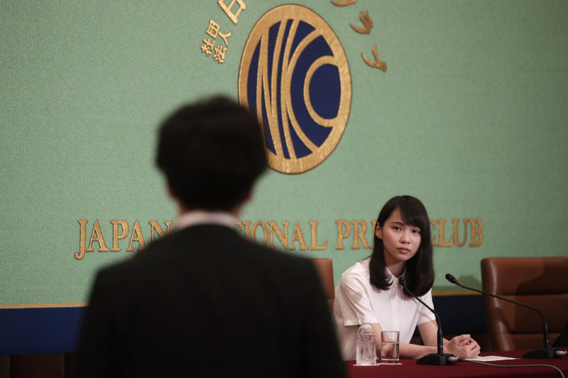 A prominent Hong Kong activist Agnes Chow listens to a question from a reporter during a press conference at Japan National Press Club Monday, June 10, 2019, in Tokyo. One of prominent student activists in Hong Kong has said many in the territory were angered by the government's bulldozing of a legislative proposal that would allow extradition of criminal suspects to mainland China, seeking international support for the resistance movement.(AP Photo/Jae C. Hong)