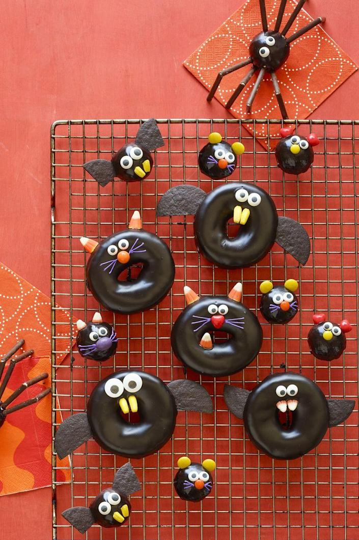 """<p>Kids will swarm around this chocolate-dipped dessert that's frightfully cute.<br></p><p><em><strong><a href=""""https://www.womansday.com/food-recipes/food-drinks/a23460042/black-cat-bat-spider-and-mice-doughnuts-recipe/"""" rel=""""nofollow noopener"""" target=""""_blank"""" data-ylk=""""slk:Get the Black Cat, Bat, Spider, and Mice Doughnut recipe"""" class=""""link rapid-noclick-resp"""">Get the Black Cat, Bat, Spider, and Mice Doughnut recipe</a>.</strong></em><em><strong><br></strong></em></p>"""