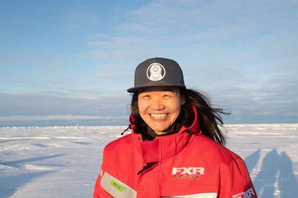 PHOTO: Dr. Allison Fong stands on the Arctic ice during the MOSAiC expedition. (Lianna Nixon)