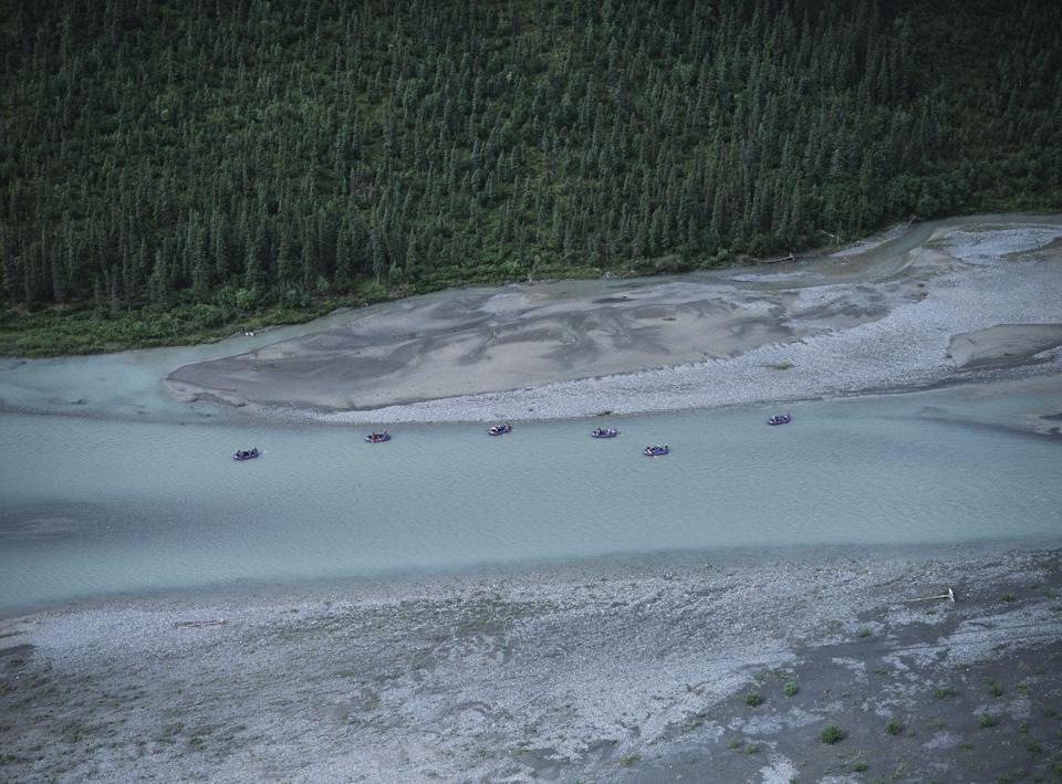 <p>A group of adventurers raft down the river at the Gates of the Arctic National Park in Alaska // Circa 2006</p>