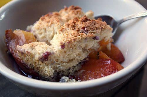 "<strong>Get the <a href=""http://www.completelydelicious.com/2010/08/dutch-oven-huckleberry-peach-cobbler.html"" rel=""nofollow noopener"" target=""_blank"" data-ylk=""slk:Dutch oven huckleberry peach cobbler"" class=""link rapid-noclick-resp"">Dutch oven huckleberry peach cobbler</a> recipe from Completely Delicious.</strong>"