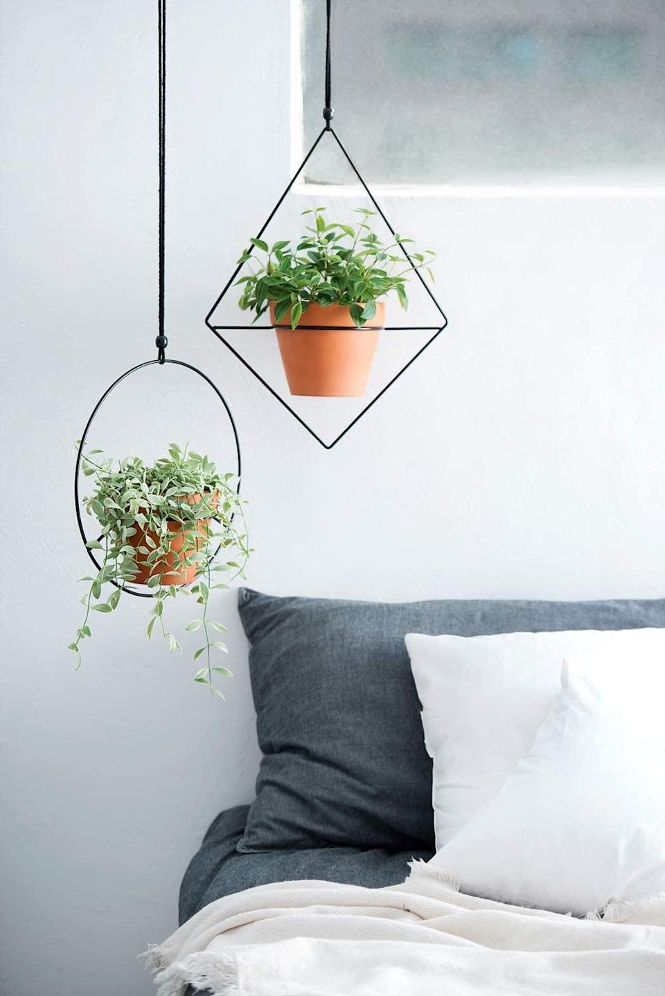 """<h2>Mkono Geometric Metal Plant Hanger Set</h2> <br>If you've got a green thumb and a contemporary sense of style, this black planter duo is for you. Its modern geometric shape sets it apart from other hanging planters, while the metal material has an industrial appeal.<br><br><strong>Mkono</strong> Geometric Metal Plant Hanger Set, $, available at <a href=""""https://amzn.to/39g1uO7"""" rel=""""nofollow noopener"""" target=""""_blank"""" data-ylk=""""slk:Amazon"""" class=""""link rapid-noclick-resp"""">Amazon</a><br>"""