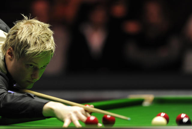Neil Robertson of Australia plays a shot against Judd Trump of England during the semi-final match in the BGC Masters snooker tournament at Alexandra Palace in north London, on January 21, 2012. Robertson went on to win the match 6-3. AFP PHOTO / CARL COURT (Photo credit should read CARL COURT/AFP/Getty Images)