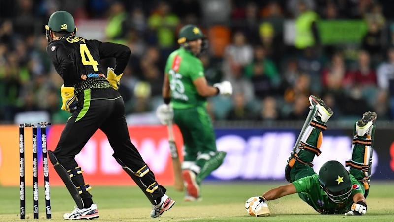 Babar Azam of Pakistan is run out by a David Warner throw in their T20 clash