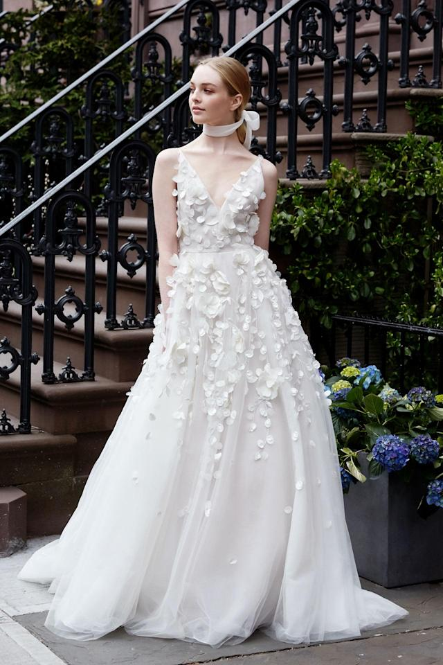 <p>White dress with floral appliqués and neck sash. (Photo: Erin Baiano) </p>