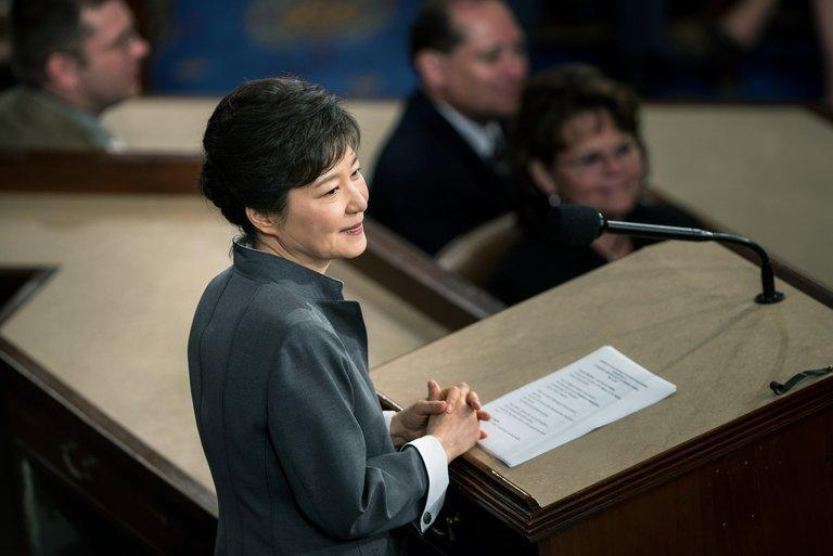 "President of South Korea Park Geun-hye addresses a joint meeting of Congress in Washington, DC, on May 8, 2013. Park fired her spokesman over an unspecified ""unsavoury"" act midway through a summit trip to the US"