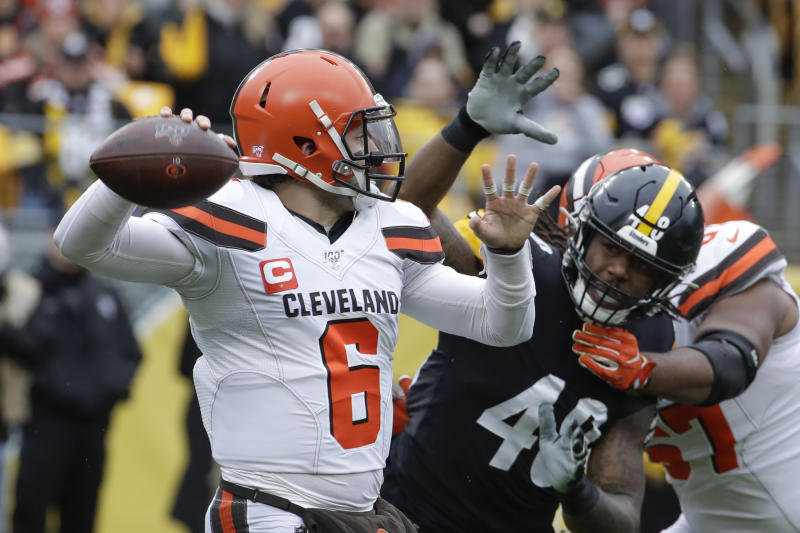 Cleveland Browns quarterback Baker Mayfield (6) passes as he is pressured by Pittsburgh Steelers outside linebacker Bud Dupree (48) in the first half of an NFL football game Sunday, Dec. 1, 2019, in Pittsburgh. (AP Photo/Gene J. Puskar)