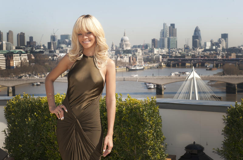 Rihanna poses for photographers in front of a London skyline atop a central London hotel during a photocall for the film 'Battleship', Wednesday, March 28, 2012. (AP Photo/Joel Ryan)