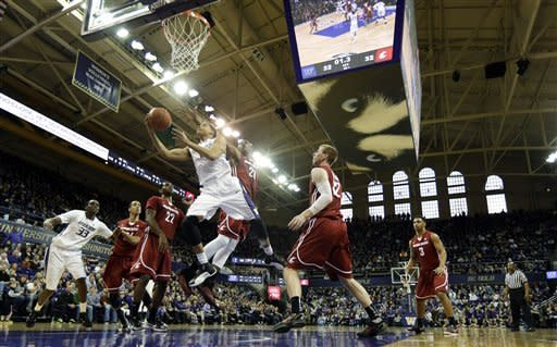 Washington's Abdul Gaddy shoots over the defense of Washington State's D.J. Shelton, center, and Brock Motum, second from right, in the first half of an NCAA college basketball game, Sunday, March 3, 2013, in Seattle. (AP Photo/Ted S. Warren)