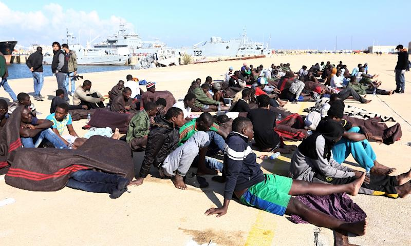 Migrants rescued by Libyan coastguards rest at the naval base in Tripoli on December 21, 2015