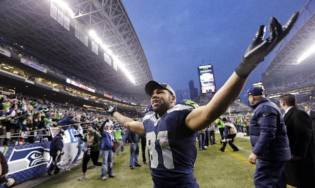 Seattle Seahawks' Golden Tate motions to fans as he leaves the field after the team beat the St. Louis Rams in an NFL football game, Sunday, Dec. 29, 2013, in Seattle. The Seahawks won 27-9. (AP Photo/Elaine Thompson)