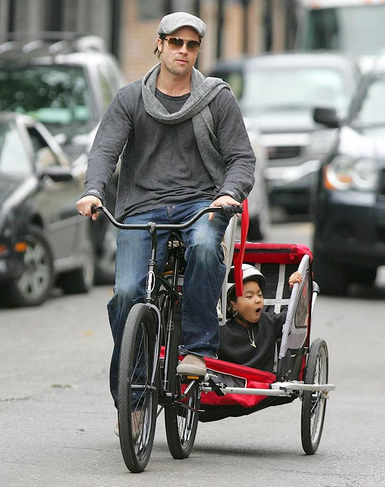 """Brad Pitt celebrated his 44th birthday last Tuesday with a family bike ride around New Orleans. The eco-friendly father (shown with son Maddox) resides part-time in Louisiana, where he is working to construct 150 homes for Hurricane Katrina victims. Thornton/Adao/<a href=""""http://www.infdaily.com"""" target=""""new"""">INFDaily.com</a> - December 18, 2007"""
