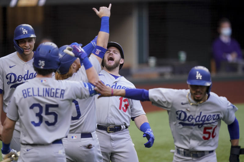 Los Angeles Dodgers' Max Muncy (13) celebrates his grand slam home run during the first inning in Game 3 of a baseball National League Championship Series against the Atlanta Braves Wednesday, Oct. 14, 2020, in Arlington, Texas. (AP Photo/Eric Gay)