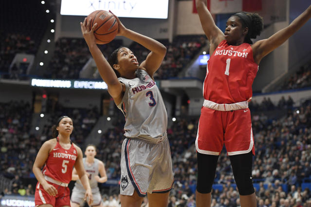 Connecticut's Megan Walker shoots as Houston's Bria Patterson, right, defends in the first half of an NCAA college basketball game, Saturday, Jan. 11, 2020, in Hartford, Conn. (AP Photo/Jessica Hill)