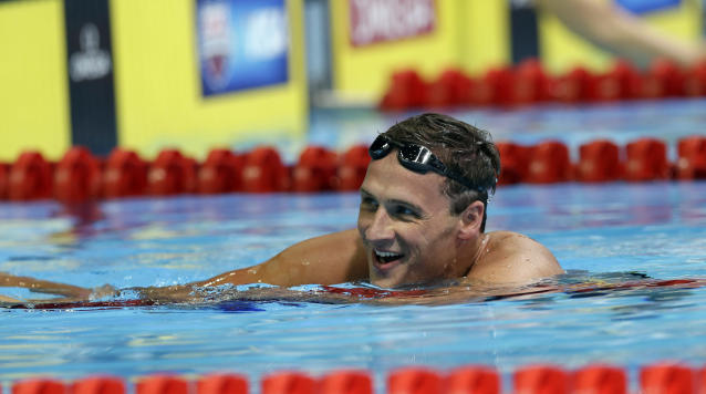 Ryan Lochte smiles after swimming in the men's 400-meter individual medley final at the U.S. Olympic swimming trials, Monday, June 25, 2012, in Omaha, Neb. (AP Photo/David Phillip)