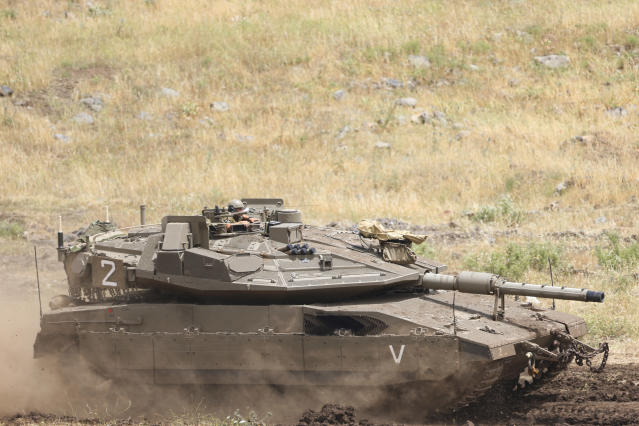 <p>An Israeli Tank drives in the Israeli-controlled Golan Heights, near the border with Syria, Thursday, May 10, 2018. (Photo: Ariel Schalit/AP) </p>