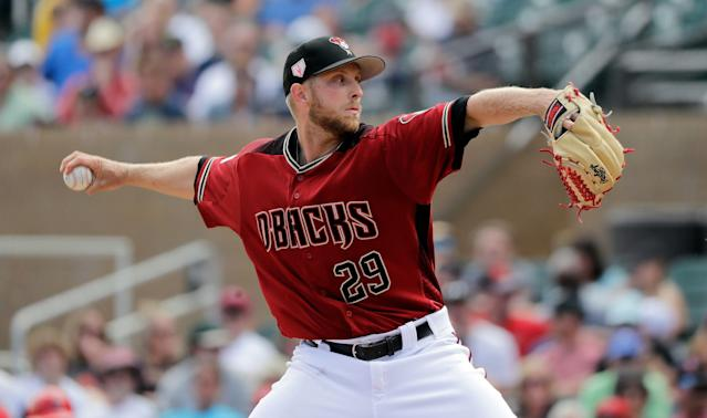 "<a class=""link rapid-noclick-resp"" href=""/mlb/teams/arizona/"" data-ylk=""slk:Arizona Diamondbacks"">Arizona Diamondbacks</a> starting pitcher <a class=""link rapid-noclick-resp"" href=""/mlb/players/11251/"" data-ylk=""slk:Merrill Kelly"">Merrill Kelly</a> experienced his first opening day on Thursday. (AP Photo)"