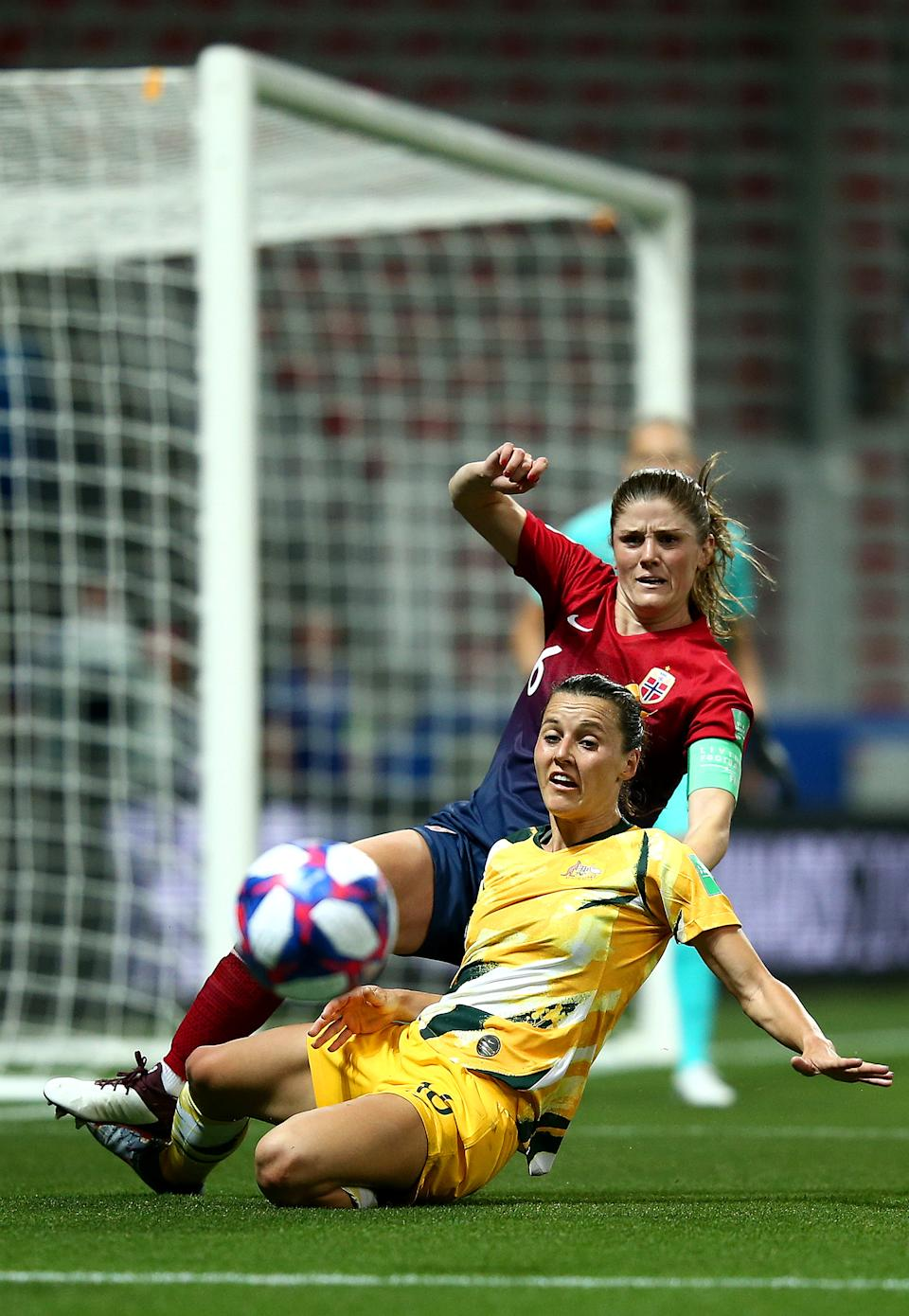 Hayley Raso of Australia is challenged by Maren Mjelde of Norway during the 2019 FIFA Women's World Cup France Round Of 16 match between Norway and Australia at Stade de Nice on June 22, 2019 in Nice, France. (Photo by Joosep Martinson - FIFA/FIFA via Getty Images)