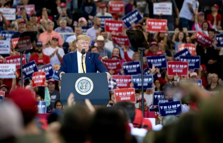 Framing himself as the victim of a Democratic and fake-news-media plot, Trump galvanized supporters at a rally in Louisiana (AFP Photo/SAUL LOEB)