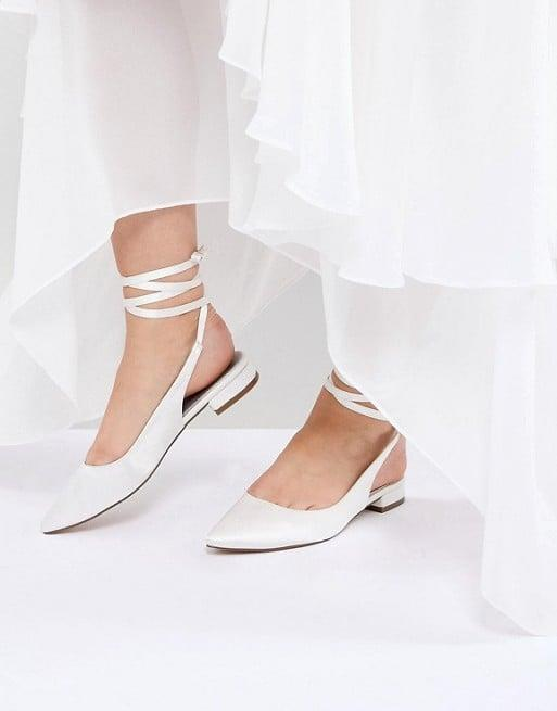 "<p>If you're into lace-up styles, get these <a href=""https://www.popsugar.com/buy/ASOS%20Design%20Lovingly%20Bridal%20Ballet%20Flats-471065?p_name=ASOS%20Design%20Lovingly%20Bridal%20Ballet%20Flats&retailer=us.asos.com&price=21&evar1=fab%3Aus&evar9=44539774&evar98=https%3A%2F%2Fwww.popsugar.com%2Ffashion%2Fphoto-gallery%2F44539774%2Fimage%2F46408415%2FASOS-Design-Lovingly-Bridal-Ballet-Flats&list1=shopping%2Cwedding%2Cshoes%2Cflats&prop13=mobile&pdata=1"" rel=""nofollow"" data-shoppable-link=""1"" target=""_blank"" class=""ga-track"" data-ga-category=""Related"" data-ga-label=""https://us.asos.com/asos-design/asos-design-lovingly-bridal-ballet-flats/prd/9282497?clr=ivory&amp;colourWayId=15031255&amp;SearchQuery=white%20flats"" data-ga-action=""In-Line Links"">ASOS Design Lovingly Bridal Ballet Flats</a> ($21, originally $35).</p>"