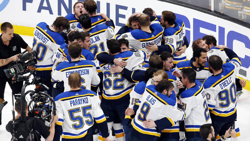 The Blues celebrate after defeating the Boston Bruins. (Photo by Rich Gagnon/Getty Images)
