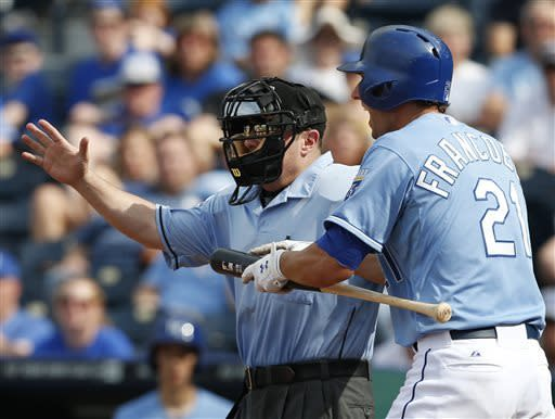 Kansas City Royals' Jeff Francoeur (21) makes his case with home plate umpire Marty Foster during the ninth inning of a baseball game against the Los Angeles Angels at Kauffman Stadium in Kansas City, Mo., Sunday, May 26, 2013. The Angels defeated the Royals 5-2. (AP Photo/Orlin Wagner)